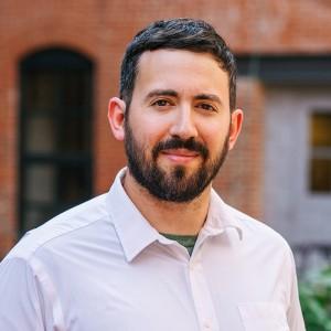 Headshot of Adam Gutter Medone Employee